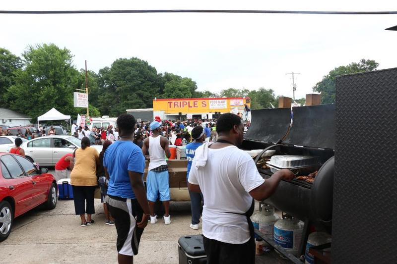 "Chef Murdock's Smokehouse, grilling across the street from the Triple S. ""I just came by because I knew they (Baton Rouge protestors) was going to be hungry."""