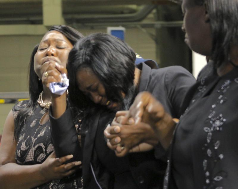 Family members enter the funeral for Alton Sterling at Southern University in Baton Rouge.