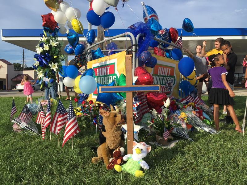 A makeshift memorial at the commercial plaza where three Baton Rouge law enforcement officers were killed.