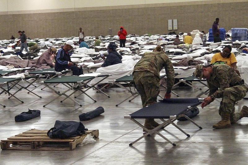 Soldiers from the Louisiana National Guard's 2228th Military Police Company headquarters in Alexandria set up cots inside of the Baton Rouge River Center August 15, 2016.