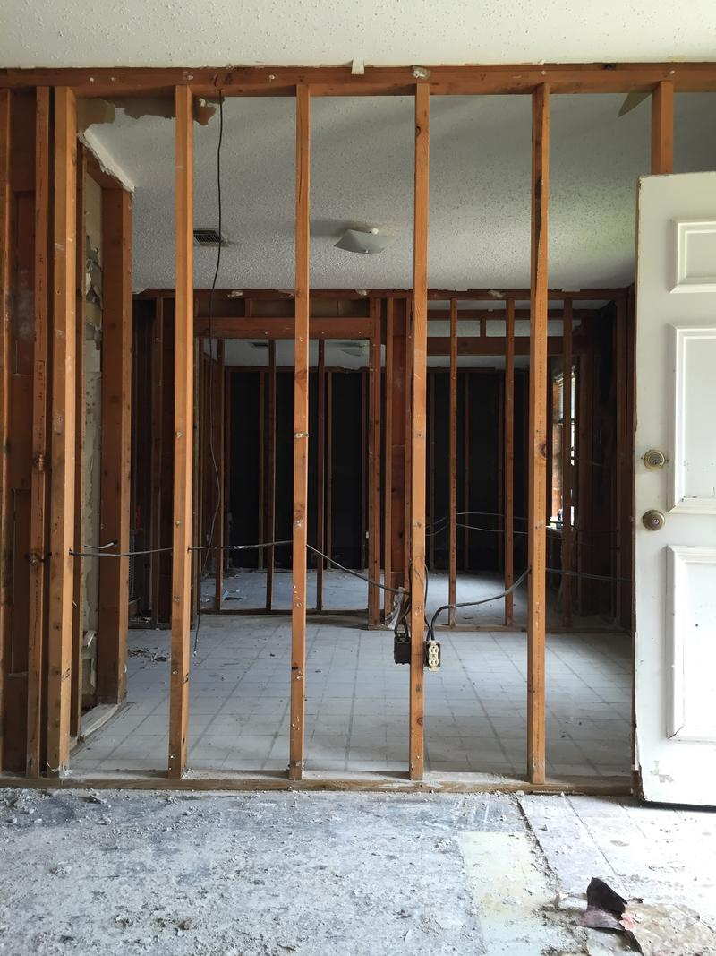 A flooded home in Baton Rouge, emptied of contents and sheetrock and insulation removed. It must have mold remediation before rebuilding can begin.