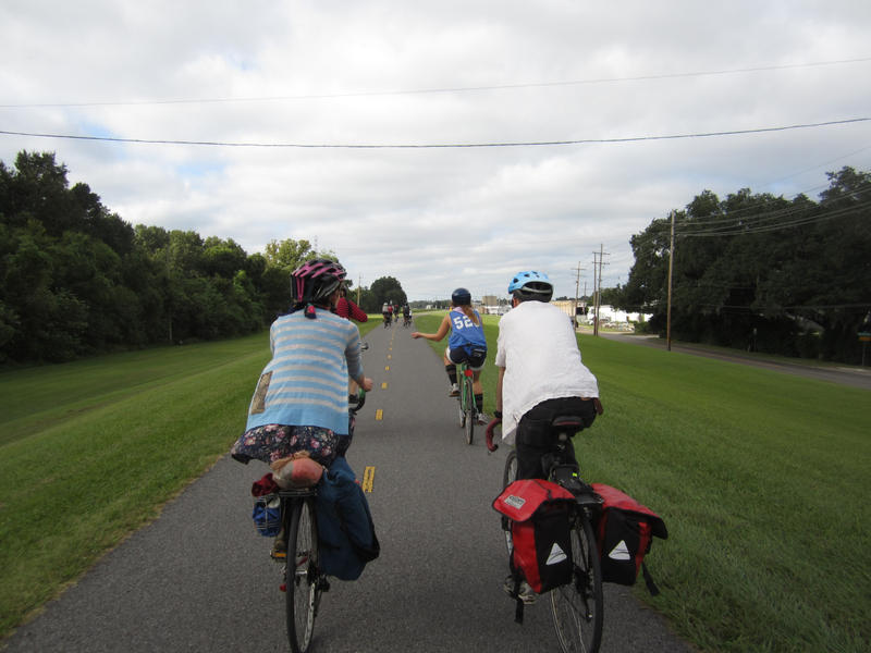 Riders take the levee path on their way to Angola Prison.