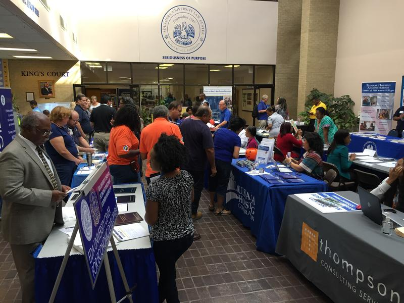 Flood affected families visit a resource fair, where aid agencies, financial lenders, and state and federal actors shared advice on home repairs and other recovery needs.