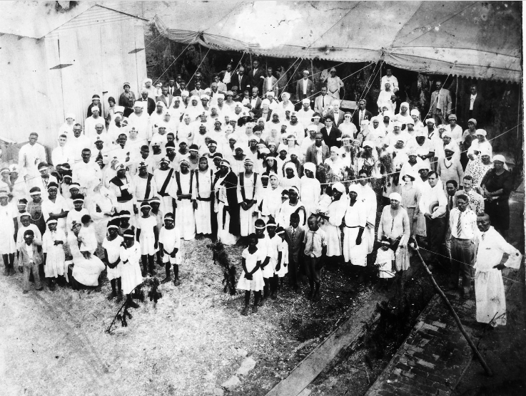 Photograph of Mother Catherine and her congregation at the Temple of the Innocent Blood, ca. 1929.