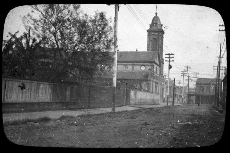 Coverglass and  matt  bound together with black paper tape.  View looking along the 1200 block of Governor Nicholls Street in Treme, with the church visible in midview.