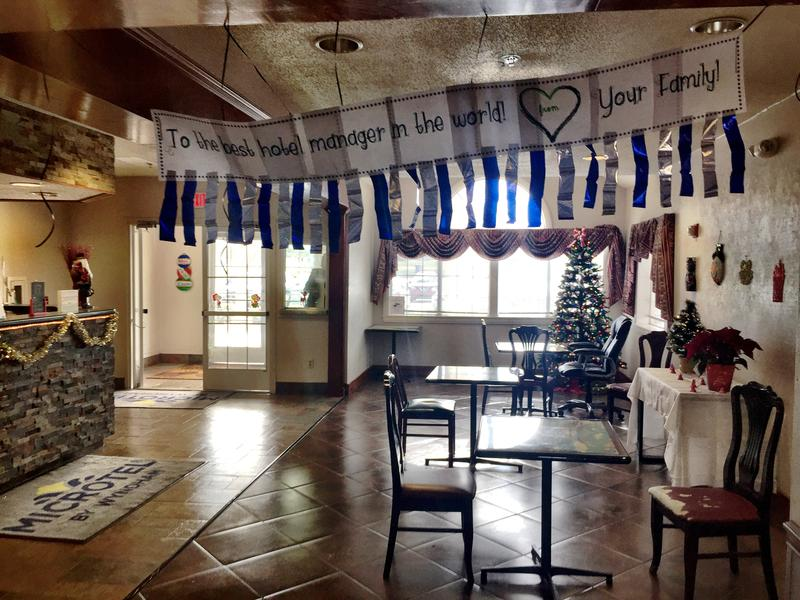 A banner hangs in a Baton Rouge Microtel lobby thanking hotel manager for all her help in assisting local families displaced long-term by August floods.