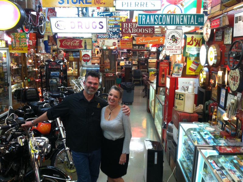 Ed Piglia and Poppy Tooker at Ed's warehouse filled with New Orleans memorabilia.