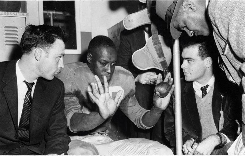 Bobby Grier speaks with representatives from the Sugar Bowl in 1956.