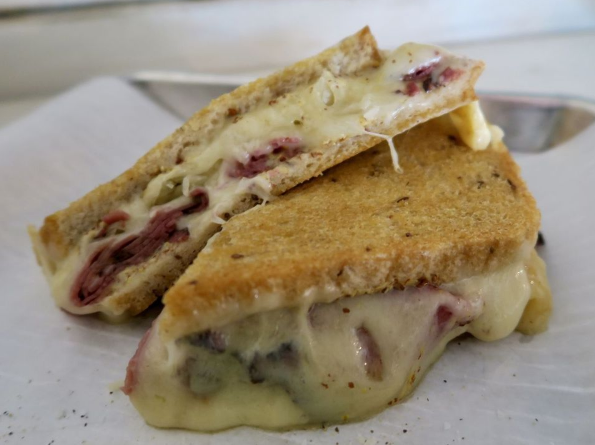 Cheese oozes from a grilled sandwich at Melt, part of a cluster of new eateries to open near New Orleans' new hospital complexes.