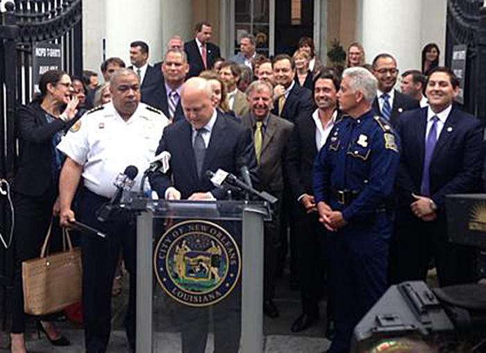 Mayor Landrieu, flanked by local and state political and business leaders, and law enforcement officials, detailing a comprehensive plan to improve policing in the French Quarter.