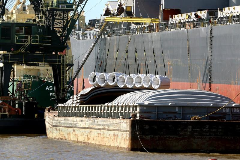 Heavy bulk cargo being loaded onto a barge at the Port of New Orleans.