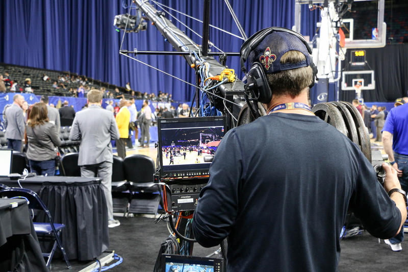 A camerman captures a Louisiana high school basketball tournament (New Orleans girls beat Baton Rouge!). His is one of many thousands of jobs created by the NBA All-Star Game.