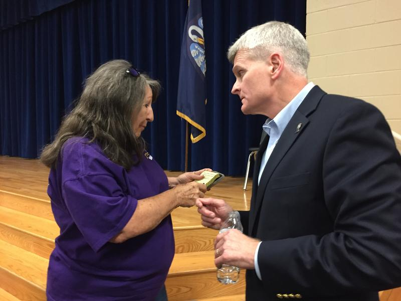 Senator Bill Cassidy (R-LA) talks to a consitutent at a town hall in Livingston Parish.
