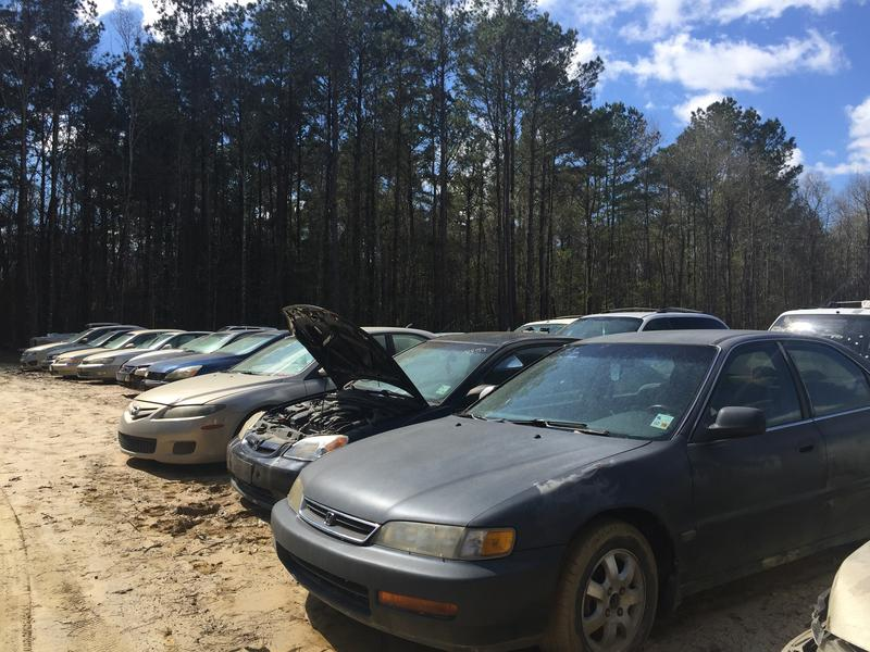 More than 300 flood damaged cars sit, waiting to get crushed, in a back lot of Stewart Towing in Livingston, Louisiana.