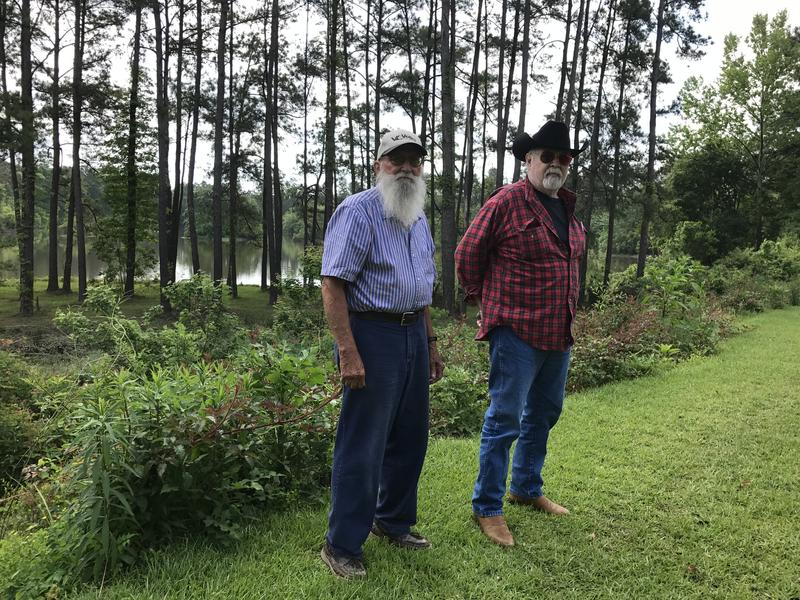 "Lawyer Byard ""Peck"" Edwards and Levi Robertson, a resident of the town Robert, stand in front of the Tangipahoa flood plain. Robertson is the plaintiff in a lawsuit against mulitple state agencies, alleging I-12 exacerbated flooding last August."