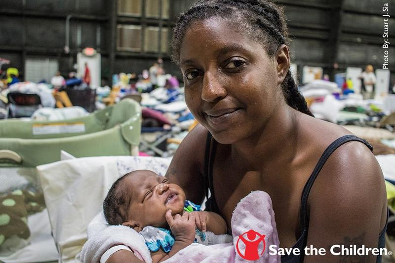 Vernesha and her 3-week- old niece, baby Joy, at a shelter for displaced families last August. Flooding drove Vernesha, her three sisters, and her three nieces from the apartment they shared. August 17, 2016