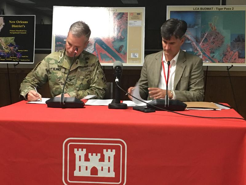 Col. Michael Clancy, US Army Corps district commander, and Amos Cormier, President of Plaquemines Parish, sign paperwork related to the Tiger Pass projects.  The projects are co-sponored by the Corps, the State of Louisiana, and Plaquemines Parish.