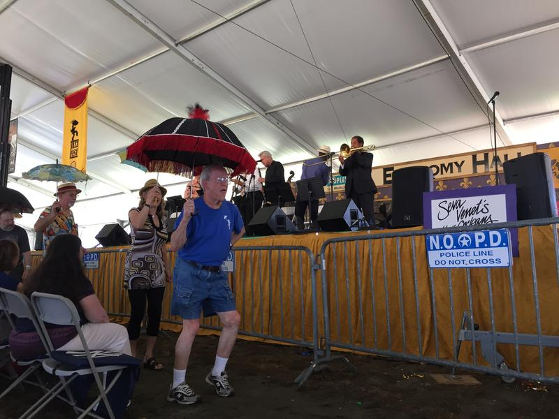 Eddie, a Jazz Fest regular, leads a Second Line in the Economy Hall tent.