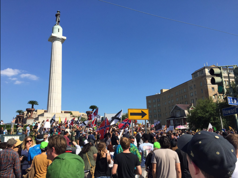 The Take Em Down NOLA Second Line to celebrate the removal of four confederate monuments arrives at Lee Circle. There they find protesters guarding the statue. Sunday, May 7th, 2017.
