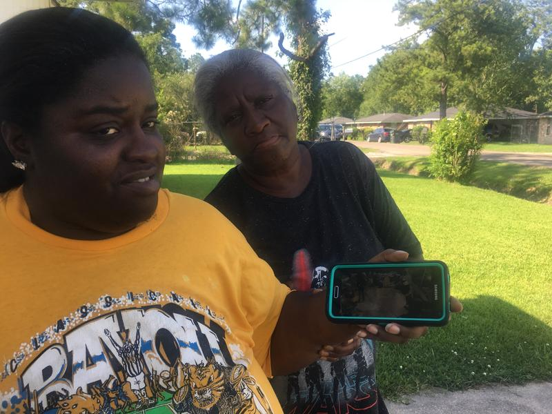 Margaret Williams and her daughter, Kalisha DeRozan, share a photo from the 2016 flood.