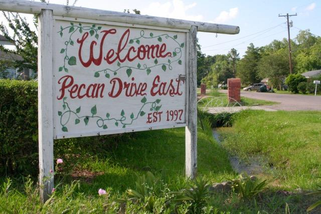 Longtime residents of Pecan Acres, many black and elderly, say they're interested in a buyout that would keep their neighborhood together in a new area.