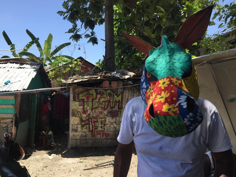 Andre Paultre wears a carnival mask in Jacmel, Haiti.