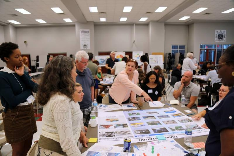 Residents gather at tables at a recent LA SAFE meeting.