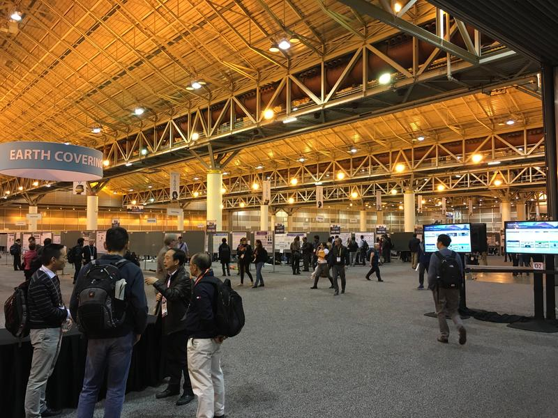 Scientists present their research in a poster hall at the American Geophysical Union conference at the New Orleans Convention Center.