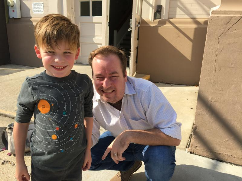 Remy Scheuermann poses with his father Craig Scheuerman after completing his test at Lusher Charter School. The Scheuermanns are trying to get Remy into first grade at some of the highest-demand schools.