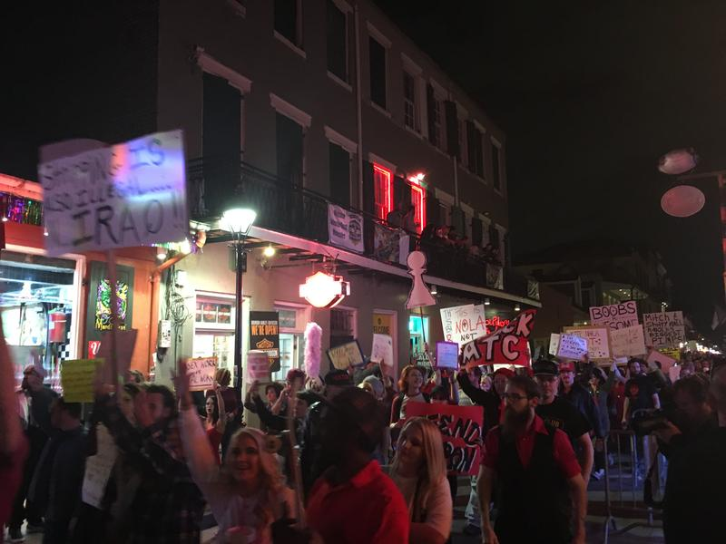 Hundreds of strip club workers and their supporters marched through the French Quarter Thursday, protesting police raids that have left them out of work.