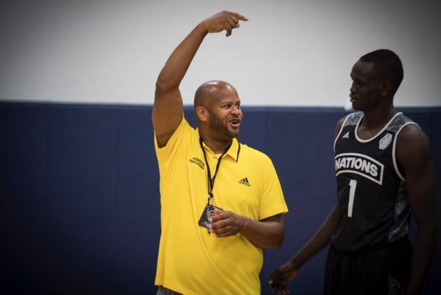 Randy Livingston working with Australian basketball player Matur Maker.