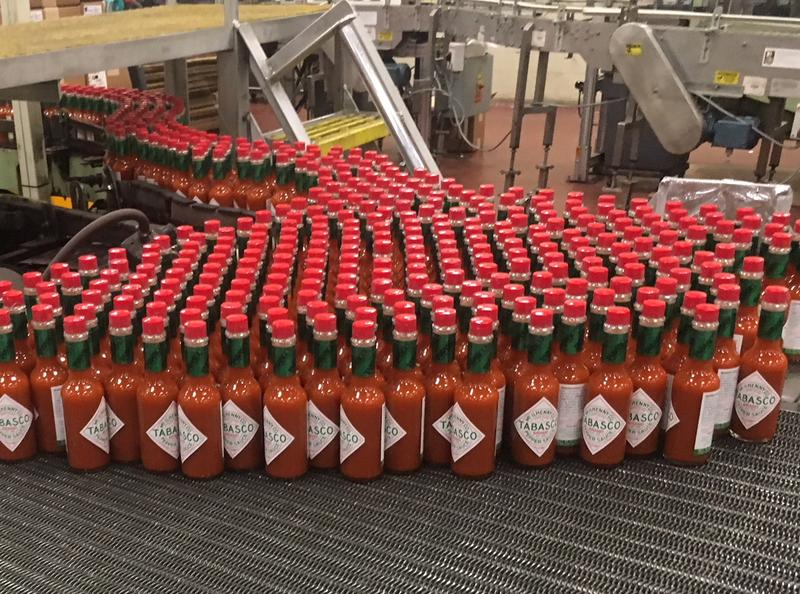 Tabasco bottles make their way down the production line at the bottling facility on Avery Island.
