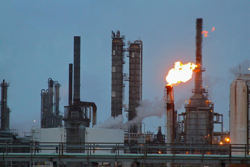 Refineries often get rid of excess refining byproducts by burning them off.  Those burning events are known as flares.