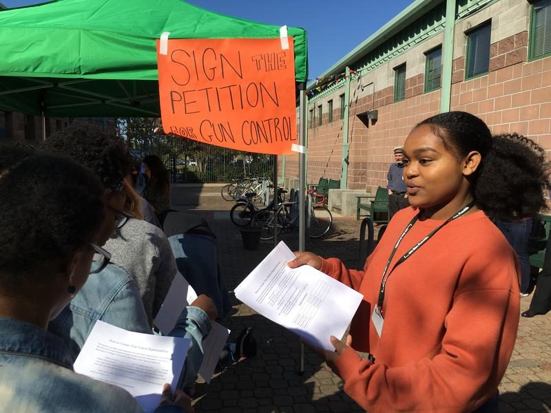Ben Franklin High School Junior Jamia Brown shows her classmates how they can contact their elected officials to call for stricter gun laws. Ben Franklin Students were among thousands nationwide who walked out of class Wednesday to protest gun violence.