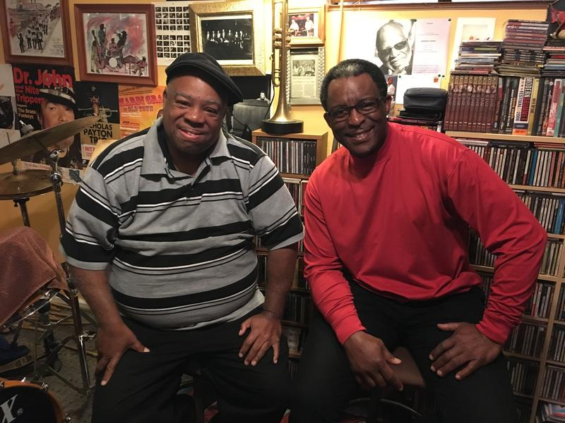 Joe Lastie (left) and Herlin Riley (right) are drummers and first cousins. They sit in Herlin Riley's music room in his home in New Orleans East.