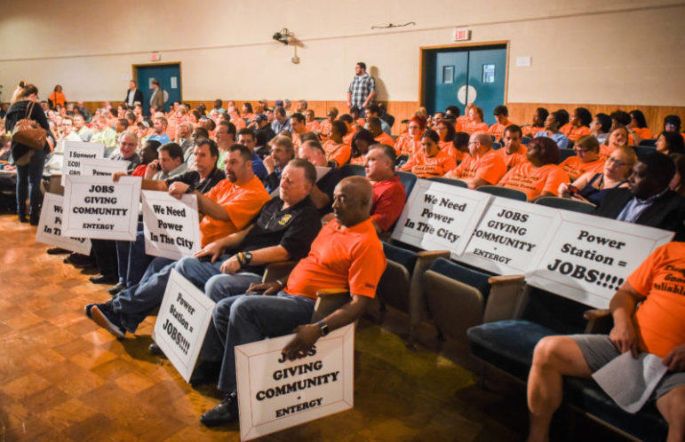 Dozens of people in bright orange shirts showed up at a public meeting last fall to show support for a proposed new Entergy power plant. Some of them were paid actors, according to a new report from The Lens.