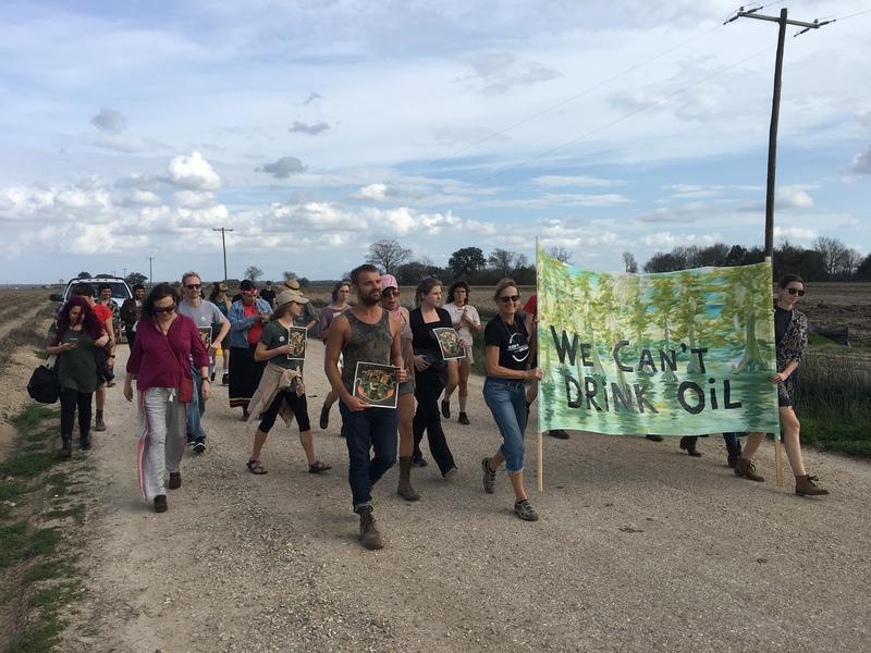Protesters march toward a Bayou Bridge pipeline construction site in early February.
