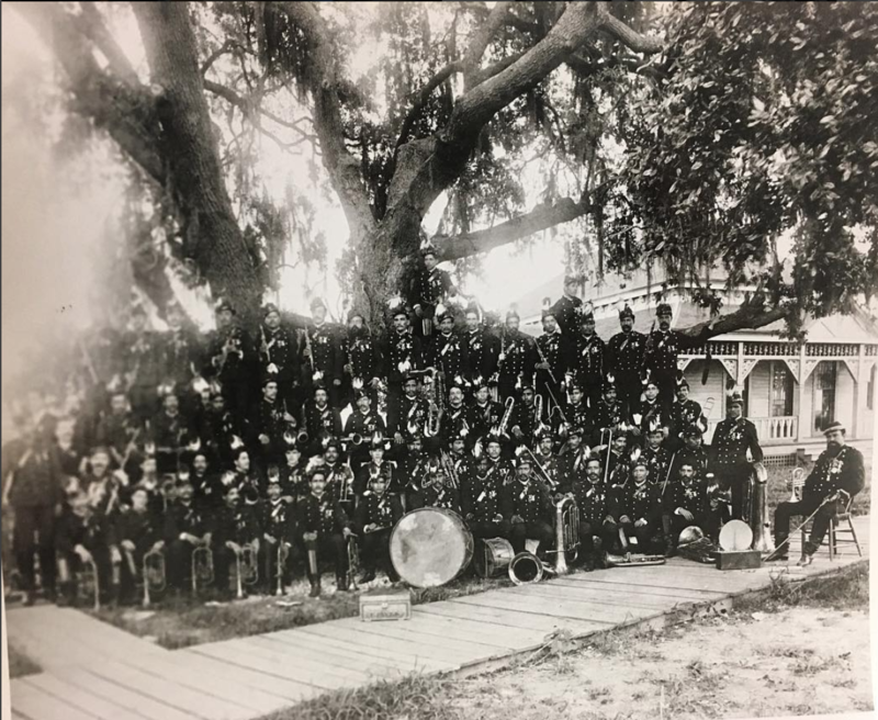 A photograph of the 8th Cavalry Mexican Military Band at the  World's Industrial and Cotton Centennial Exposition in 1884.