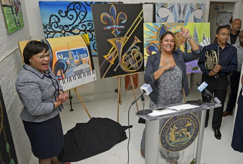 Mayor LaToya Cantrell (L), artist Ursula Rochon at podium