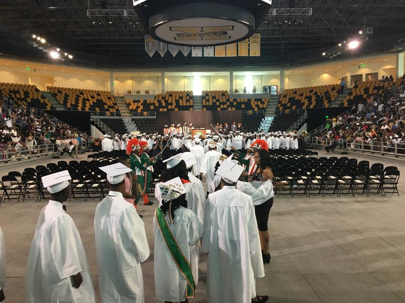 George Washington Carver High School class of 2018 files in for their graduation ceremony.