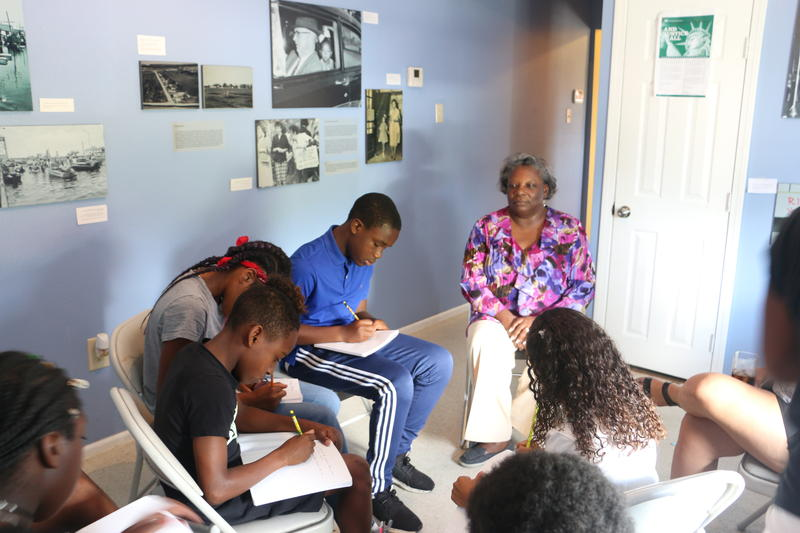 Civil rights pioneer Leona Tate takes questions from students in her summer camp.