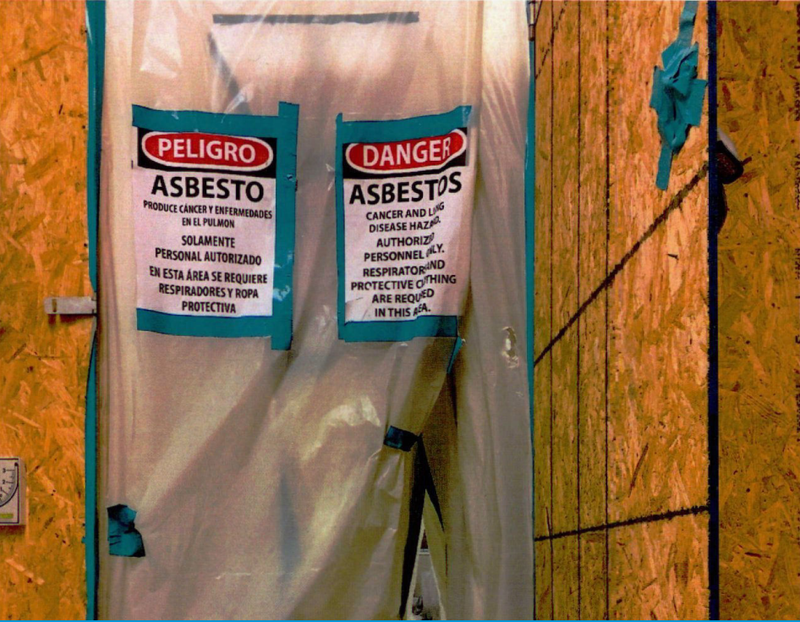 A photo from a 2017 LDEQ report showing an unsecured asbestos containment area at Lafayette Academy Charter School.