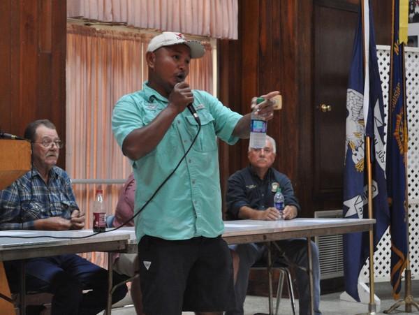 Houma shrimper Sopin Men discusses a potential shrimpers strike at a meeting of the Louisiana Shrimp Association in Houma on Wednesday.