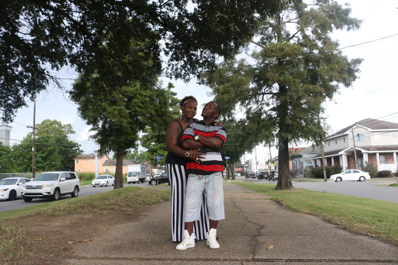 Cheundra Bailey and Ernest Canty embrace in their favorite spot to unwind - the neutral ground on Caliborne Ave. The two have criminal records, but are determined to find legal work.