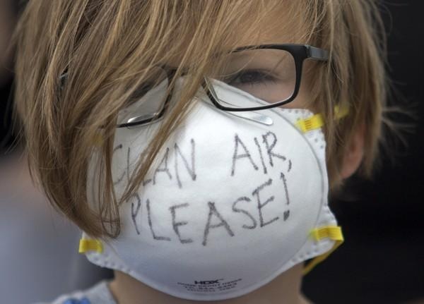 Matthew Walker, 8, protests Jefferson Parish landfill odors before a Parish Council meeting at the Joseph S. Yenni Building in Elmwood on Aug. 17.