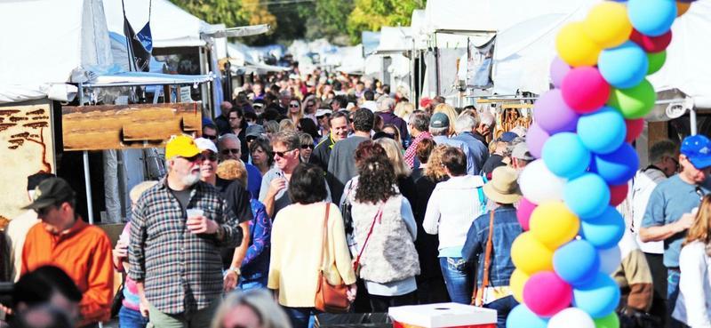 Three Rivers Art Festival transforms Covington's main street into an exhibition.