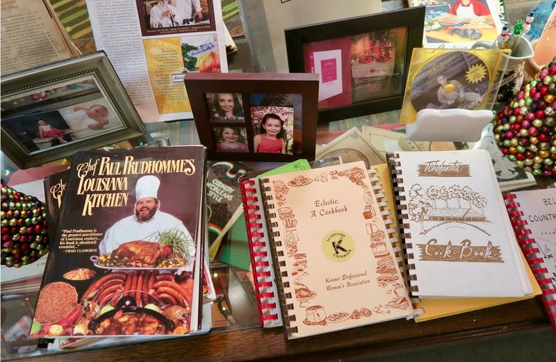 Old cookbooks filled with recipes and stories fill a table at the Kitchen Witch store in New Orleans.
