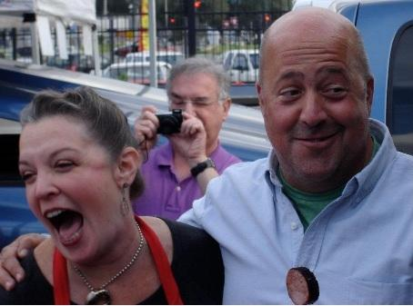Andrew Zimmern and Poppy Tooker palling around at the Crescent City Farmer's Market.