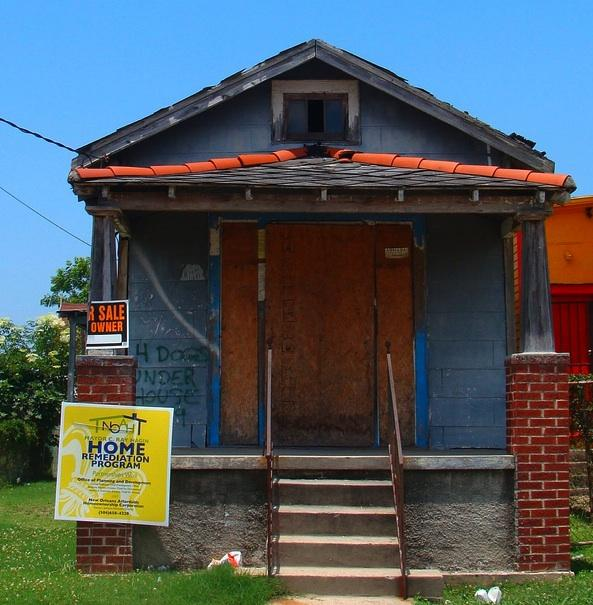 City officials used bright signs to tout remediation work by the New Orleans Affordable Homeownership program.