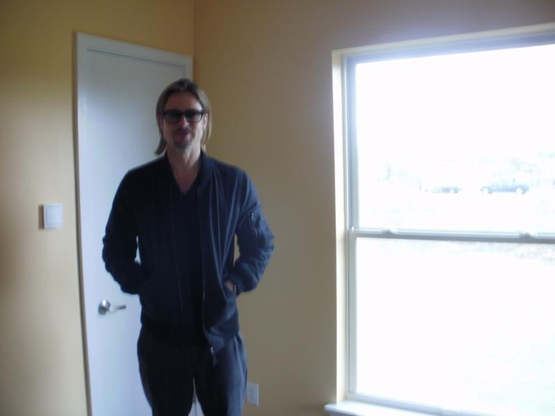 Brad Pitt in a new Make it Right home almost ready for occupancy.